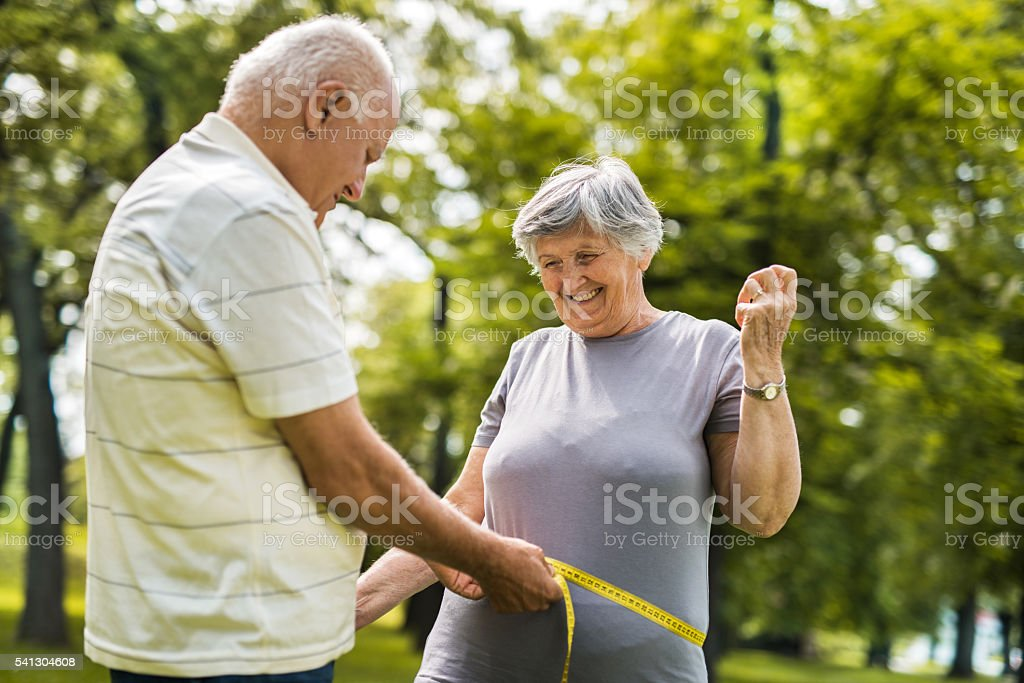 Let's measure your waist! stock photo