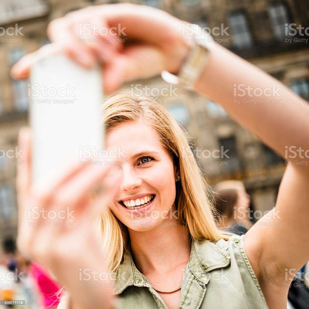 lets take a selfie in amsterdam stock photo