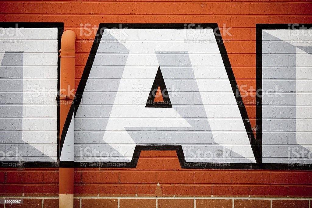 Letter 'A' against painted Brick Wall royalty-free stock photo