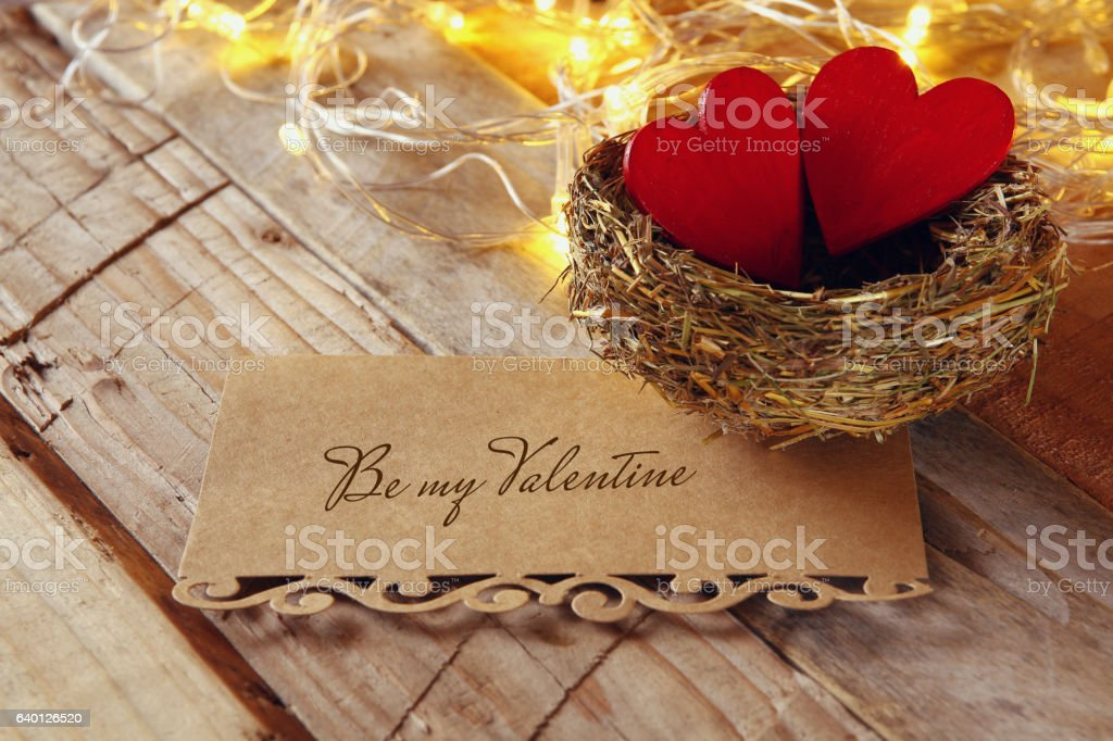 letter and couple of hearts in the bird nest stock photo