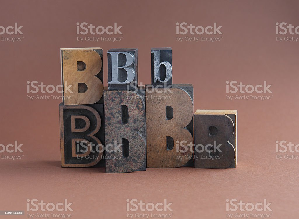 letter B in wood and metal type stock photo