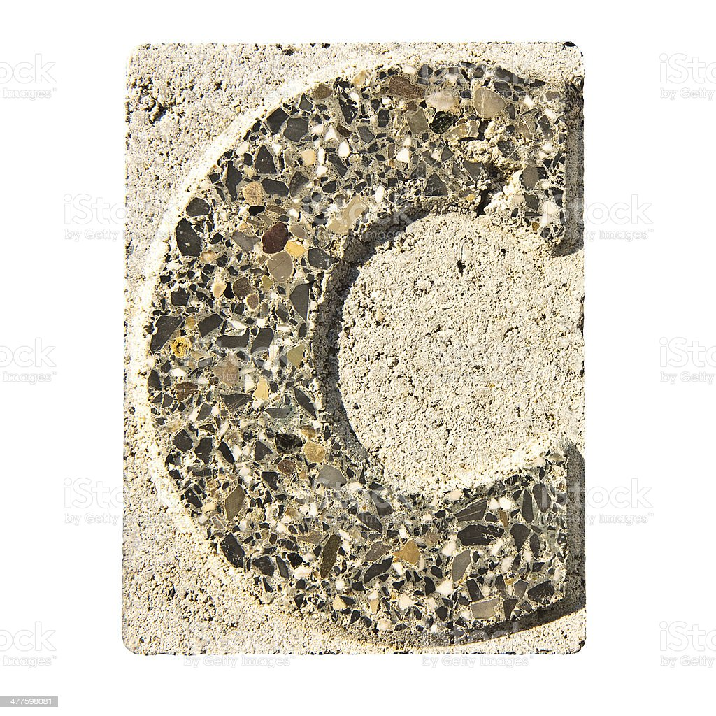 Letter C carved in a concrete block royalty-free stock photo