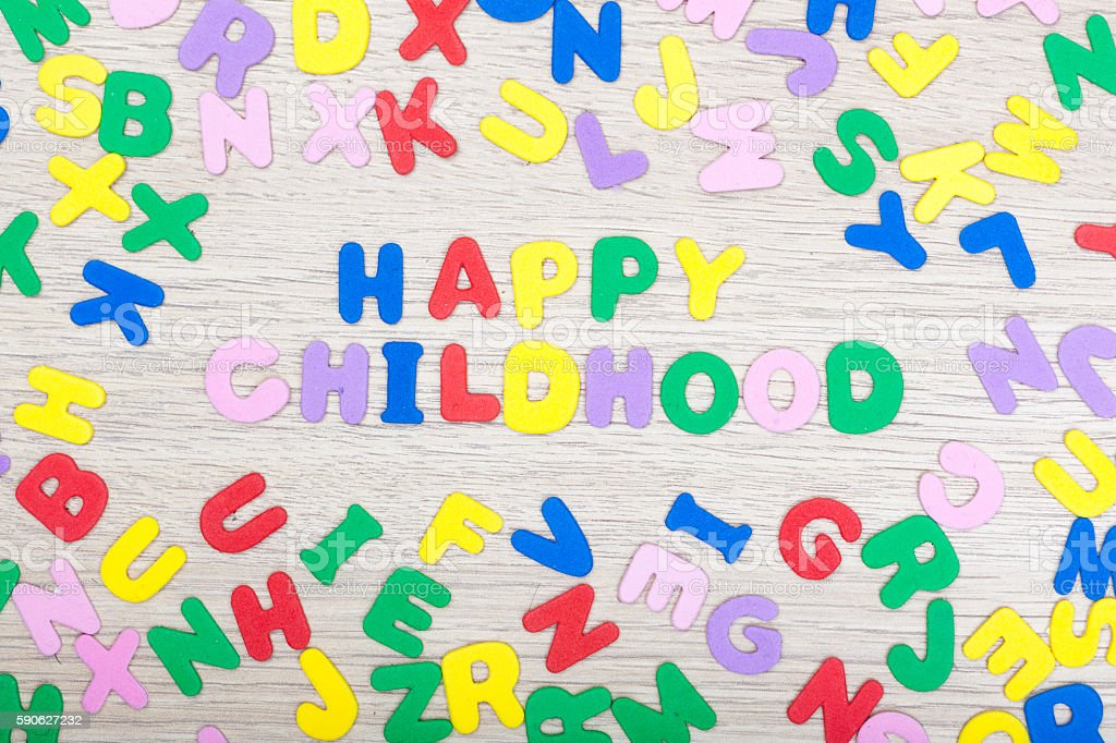 Letter cluster with Happy Childhood stock photo