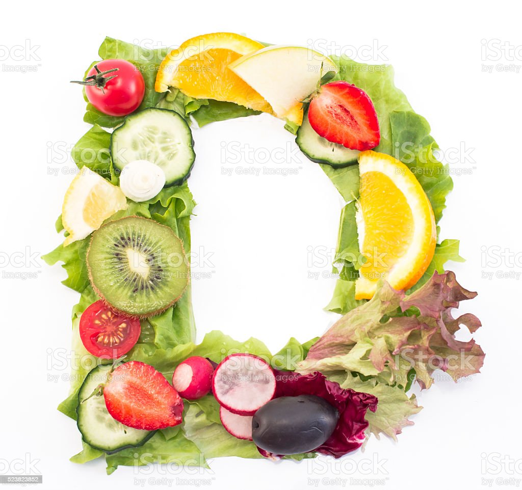 Letter D made of salad and fruits stock photo