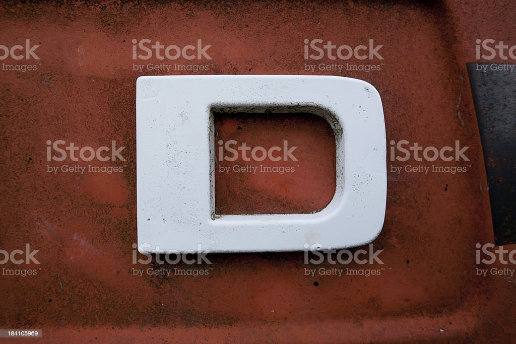 letter D on old metal stock photo