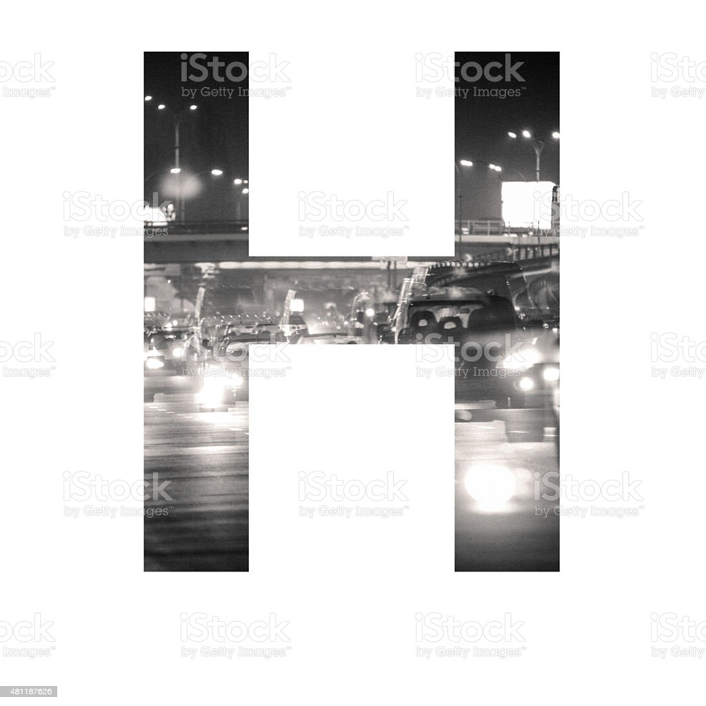 letter double exposure with black and white city traffic ABC stock photo