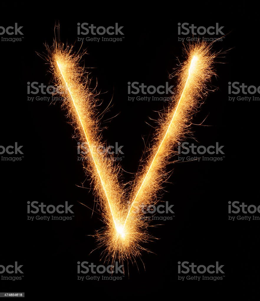 'V' letter drawn with bengali sparkles stock photo