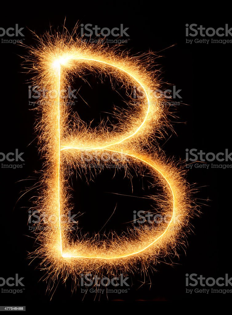 'B' letter drawn with bengali sparkles stock photo