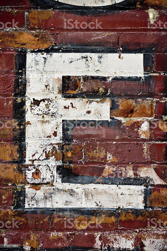 letter E on brick wall stock photo