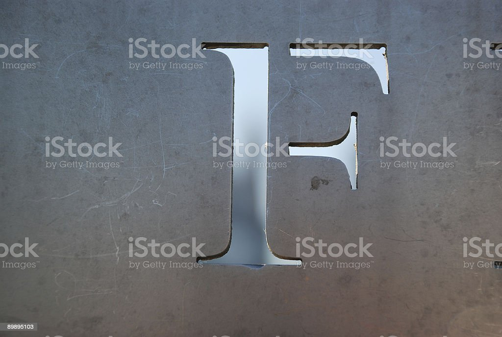 letter F cutout of metal royalty-free stock photo