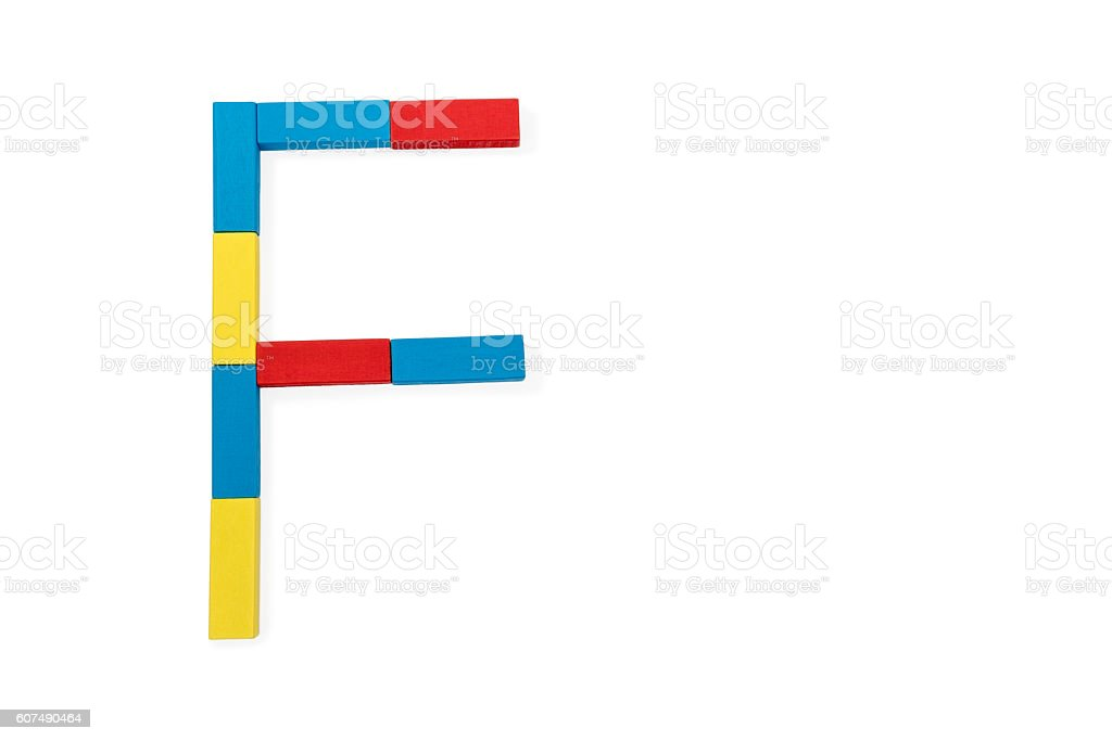 Letter F is folded of wooden blocks stock photo
