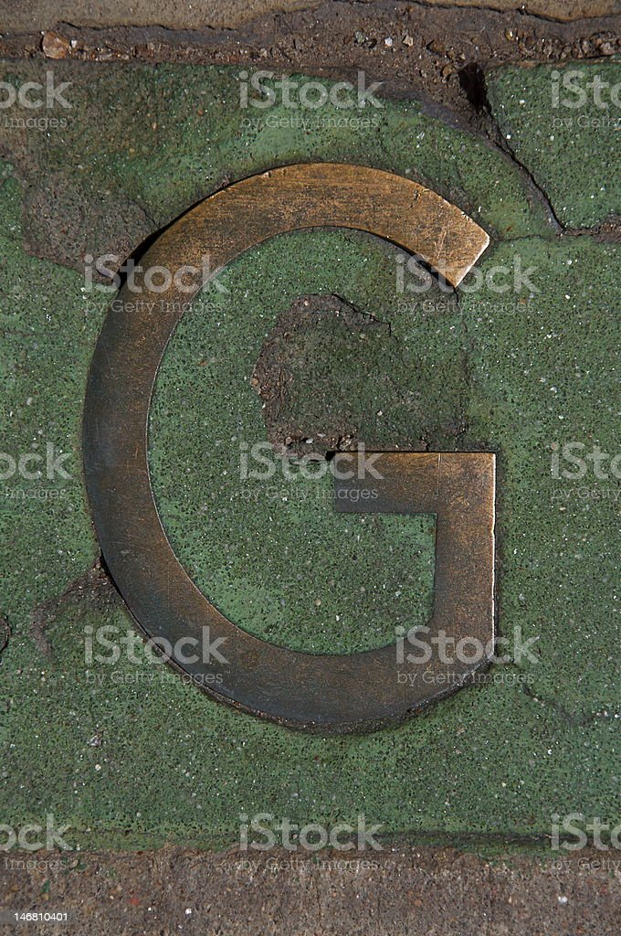 Letter G in Metal and Cement stock photo