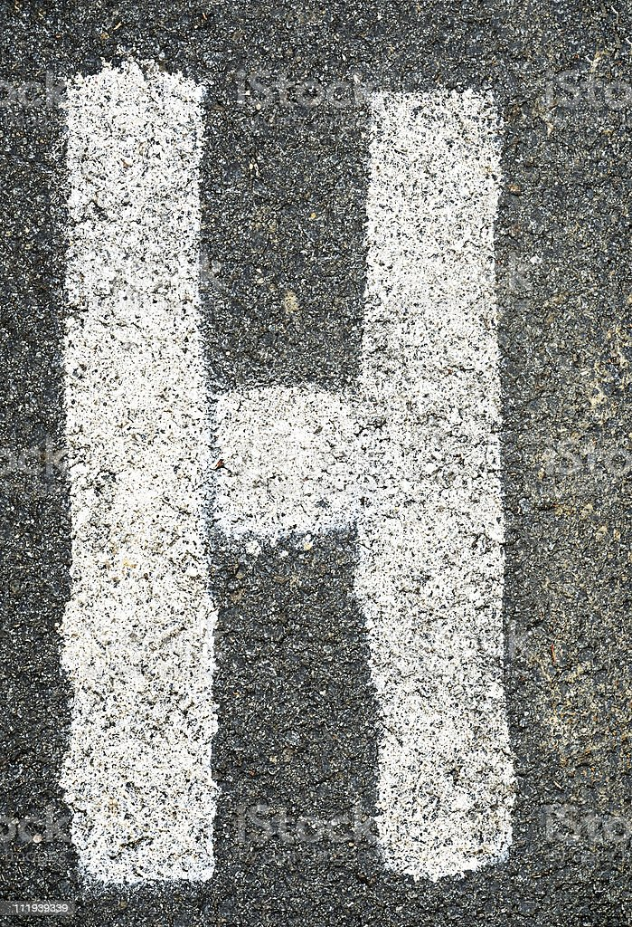 Letter H on asphalt royalty-free stock photo
