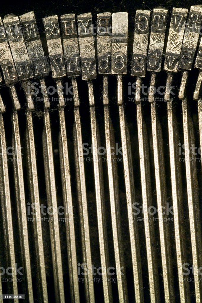 Letter hammers on a old typewriter royalty-free stock photo