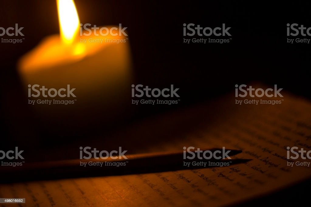 Letter in candlelight stock photo