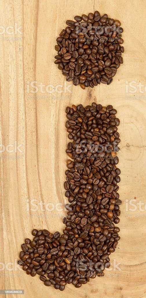 Letter J, alphabet from coffee beans royalty-free stock photo