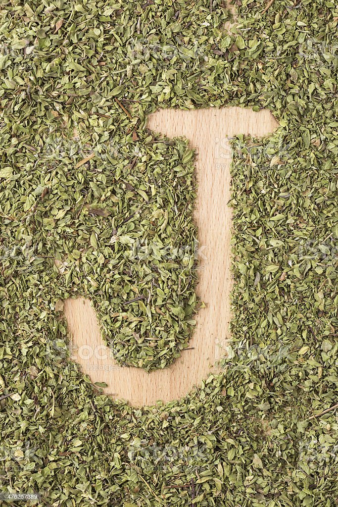 Letter J written with oregano royalty-free stock photo
