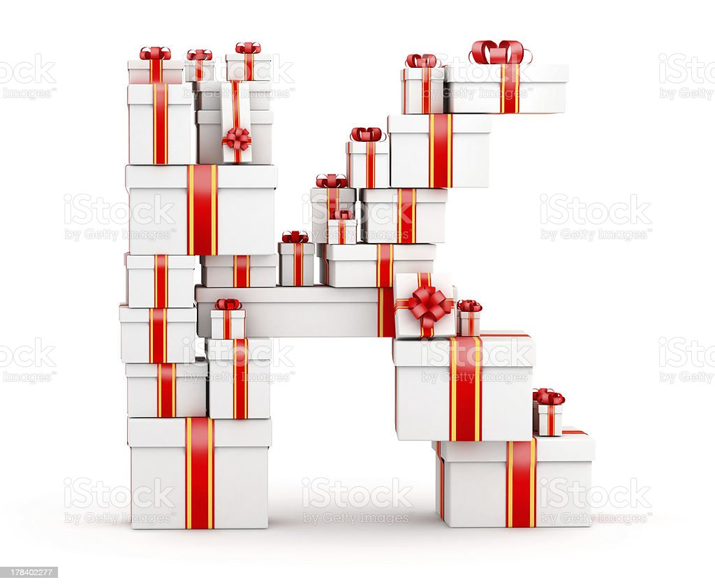 Letter K from boxes of gifts decorated with red ribbons royalty-free stock photo