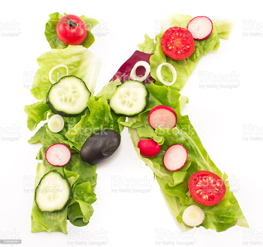 Letter K made of salad stock photo
