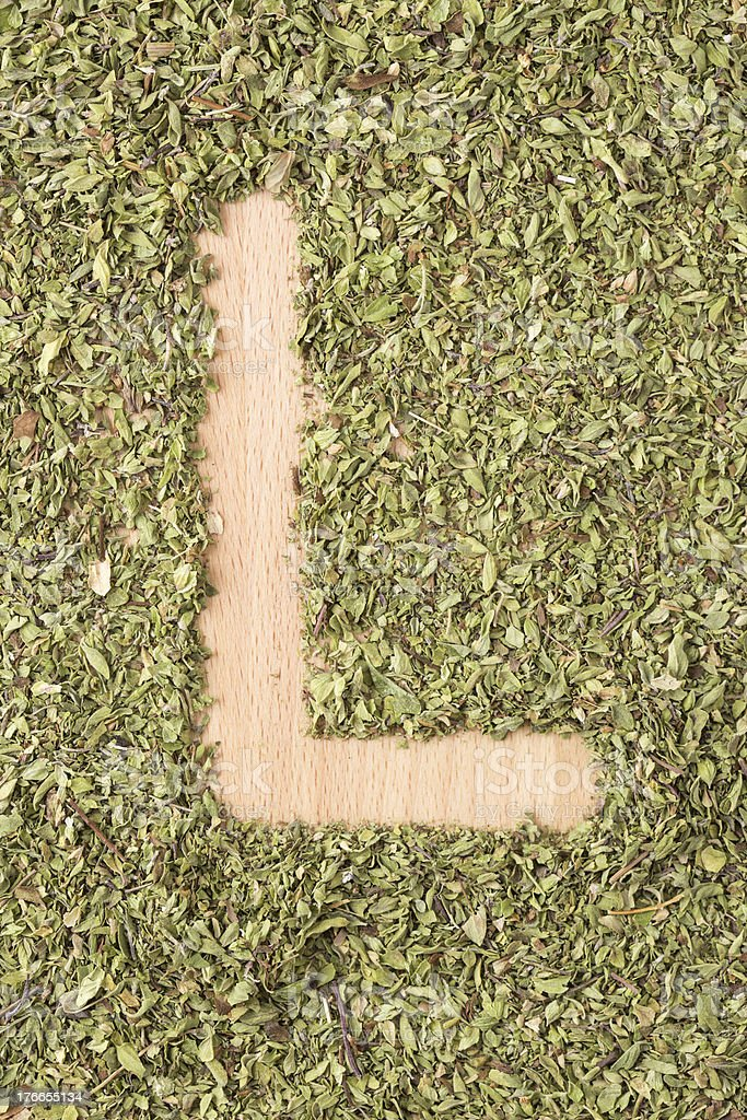 Letter L written with oregano royalty-free stock photo