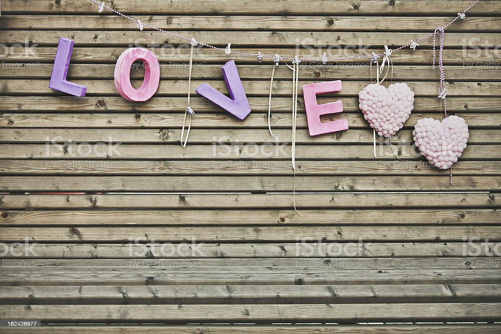 Letter love on wooden wall royalty-free stock photo