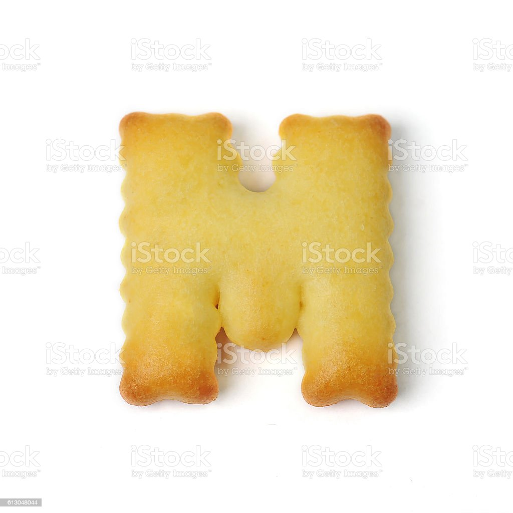 letter M made of cracker cookie isolated on white background stock photo