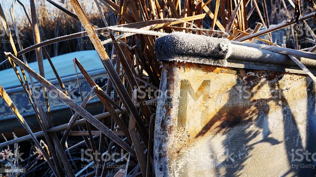Letter M on a Frost Covered Boat stock photo