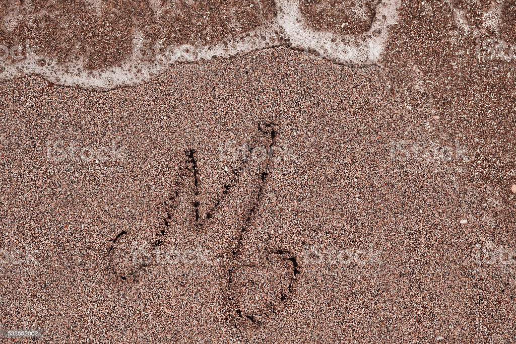 letter M on the beach stock photo