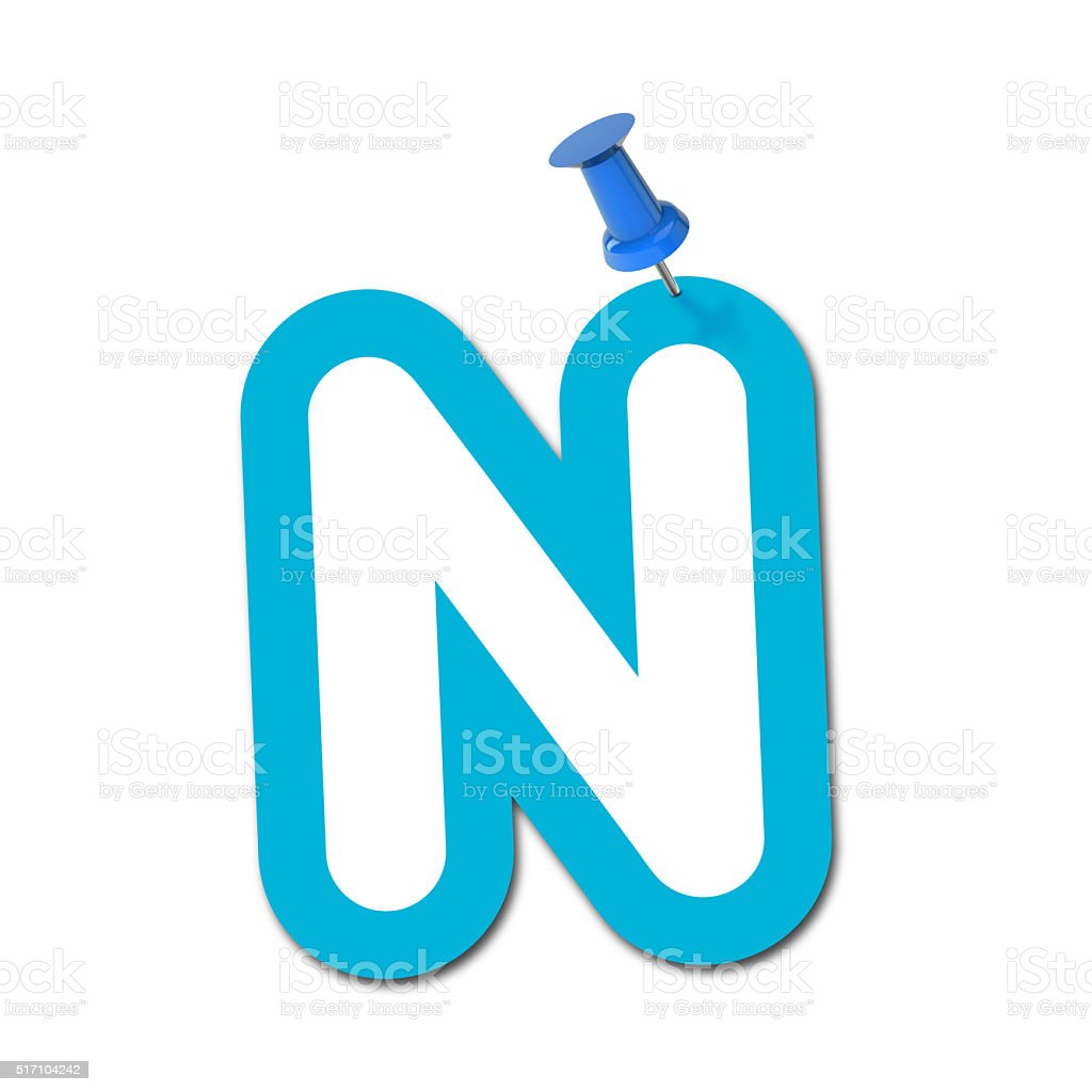 Letter N pinned to a plain white background stock photo