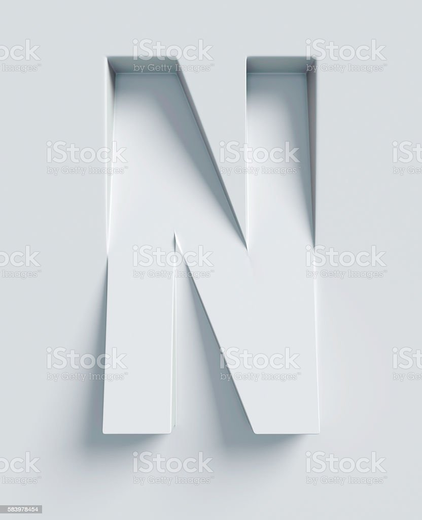 Letter N slanted 3d font engraved and extruded from surface stock photo