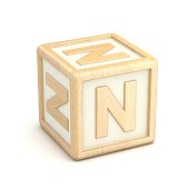 Letter N wooden alphabet blocks font rotated. 3D