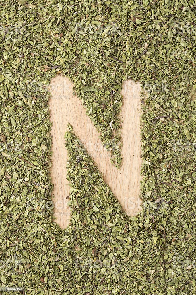 Letter N written with oregano royalty-free stock photo
