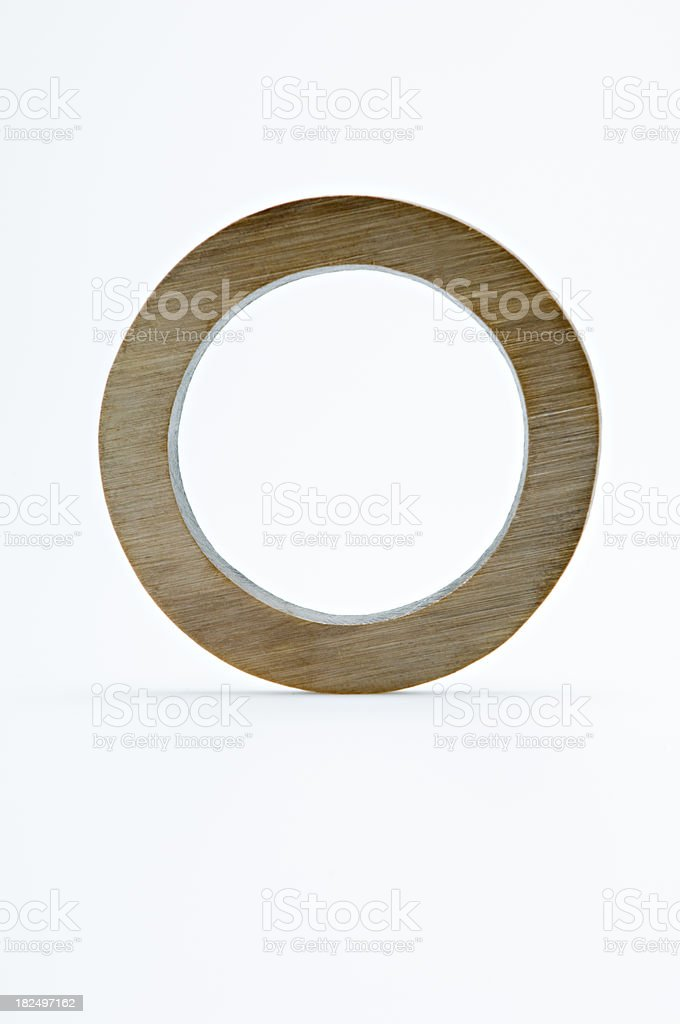 Letter O Made of Brass White Background royalty-free stock photo