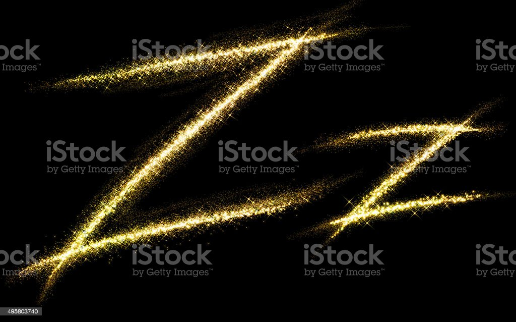 Z letter of gold glittering stars dust flourish tail stock photo