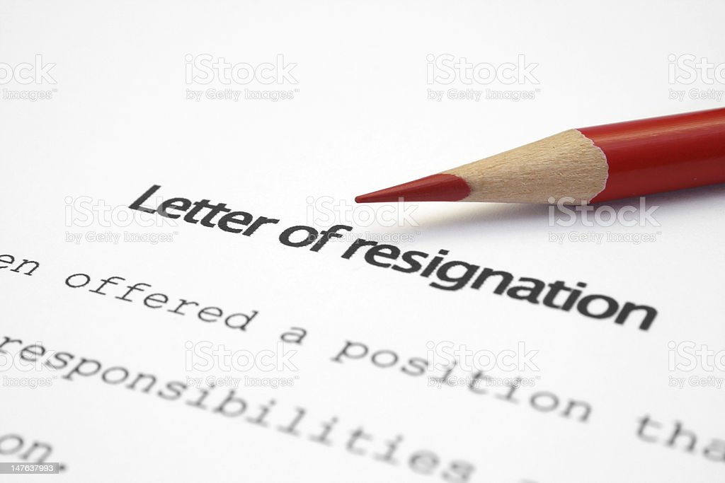 A letter of resignation with a red colored pencil on top stock photo