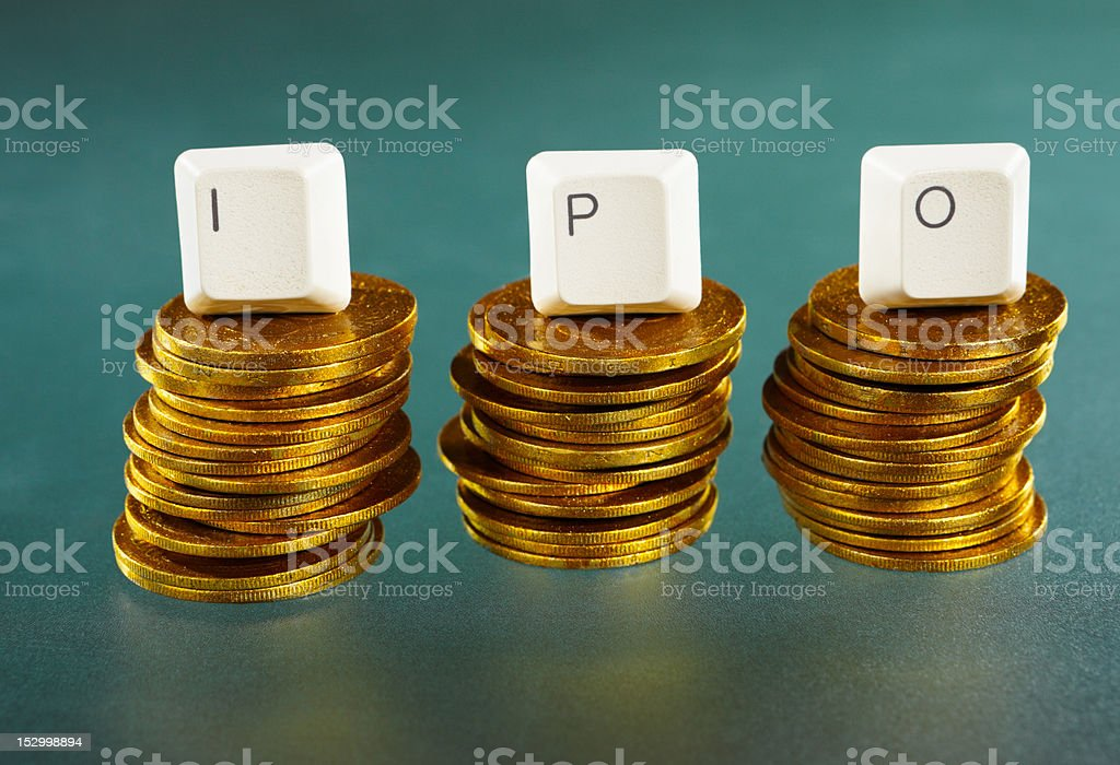 IPO letter on gold coins stack stock photo