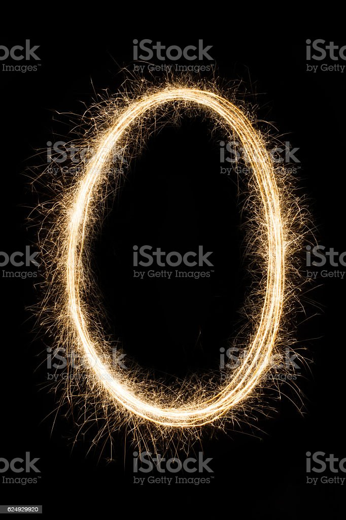 Letter or number null O from sparklers alphabet on black stock photo