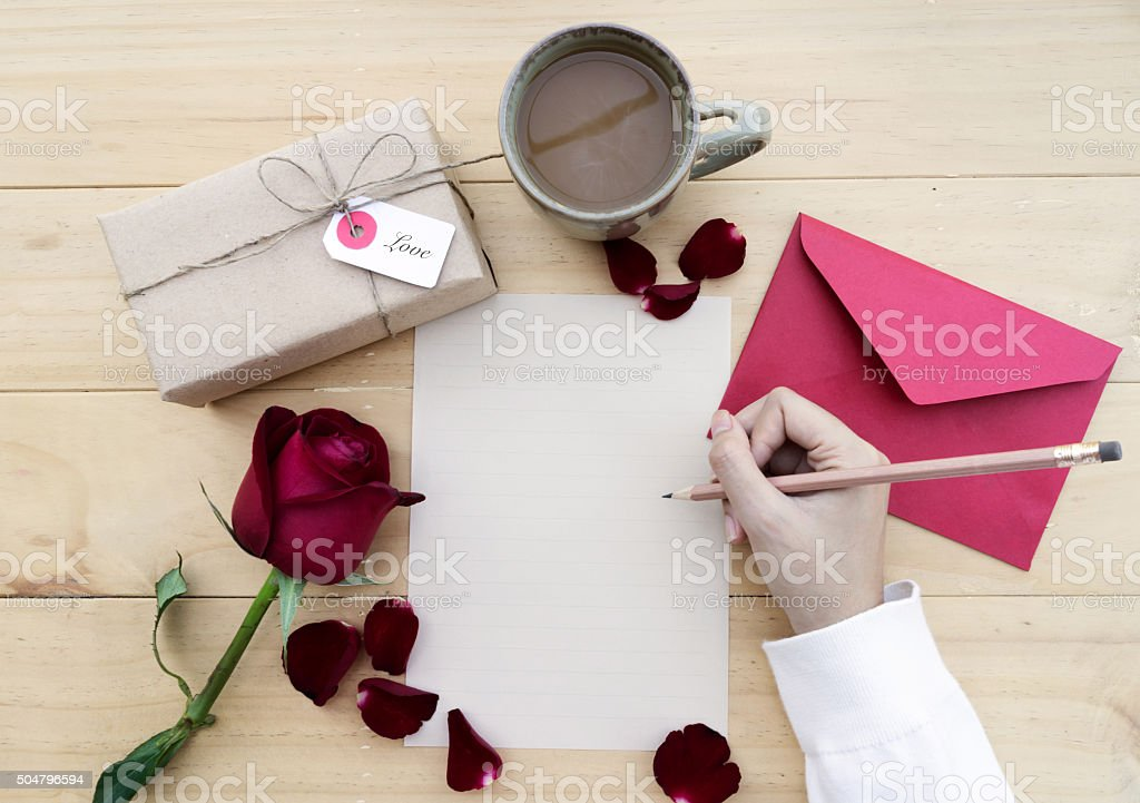letter paper for Valentine's day with gift box stock photo
