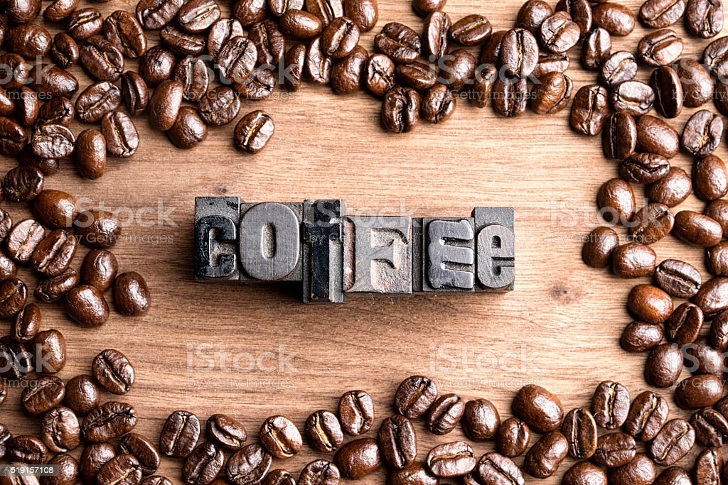 Letter Press Blocks Spelling Coffee with Whole Beans on Wood stock photo