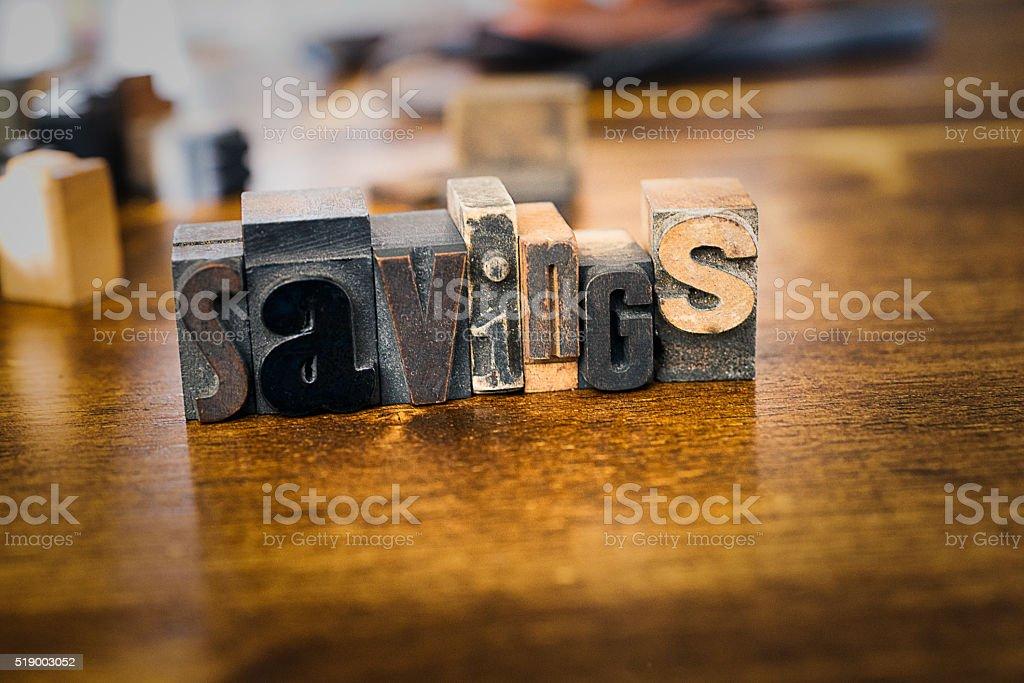 Letter Press Blocks spelling the word Savings stock photo