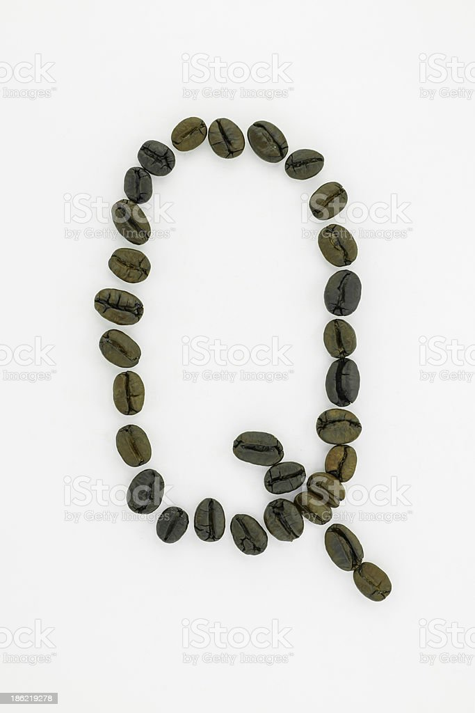 Letter Q, alphabet from coffee beans isolated on white background stock photo
