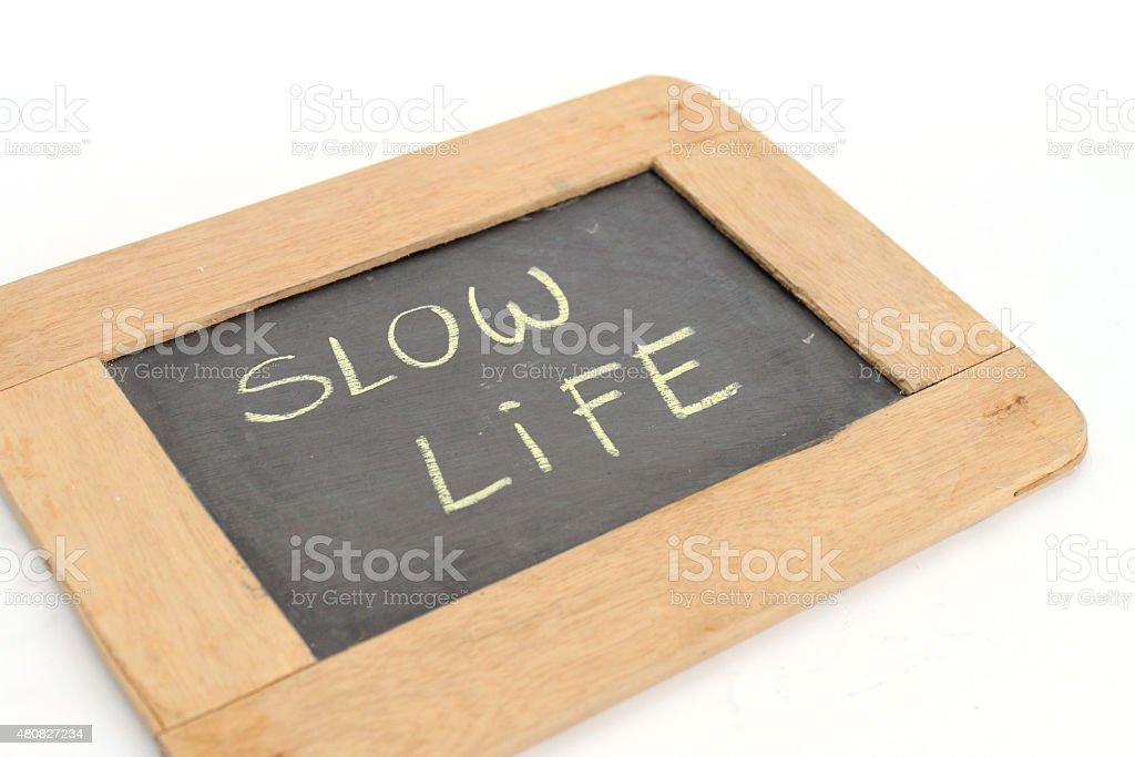 letter slow life write on chalkboard stock photo