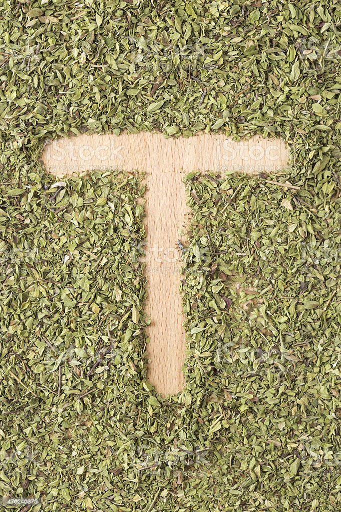 Letter T written with oregano royalty-free stock photo