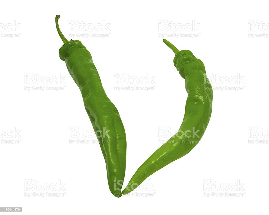 Letter V composed of green peppers royalty-free stock photo