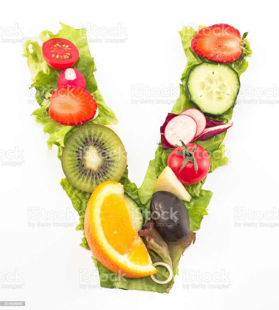 Letter V made of salad and fruits stock photo