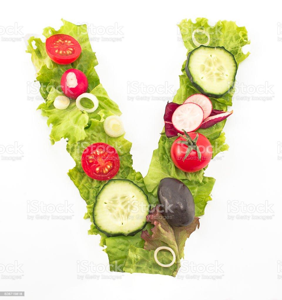 Letter V made of salad stock photo