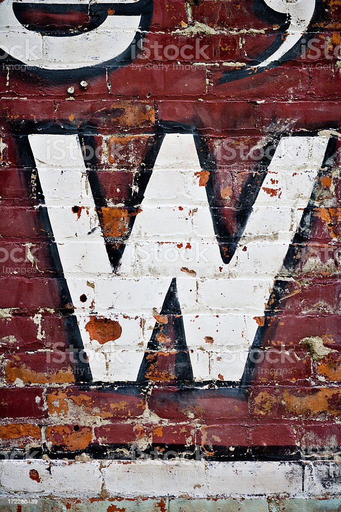 letter W on brick wall stock photo