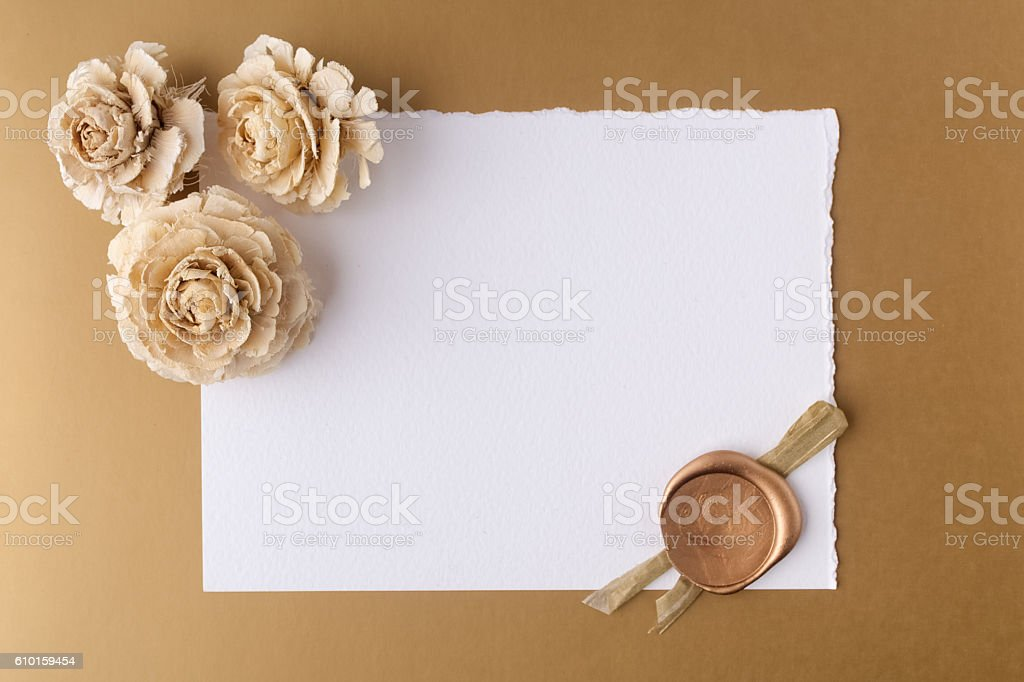 Letter with wax seal and dry roses on golden background stock photo