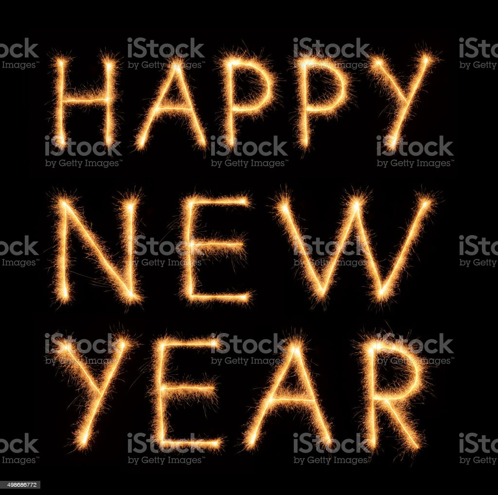 'HAPPY NEW YEAR' lettering drawn with bengali sparkles stock photo