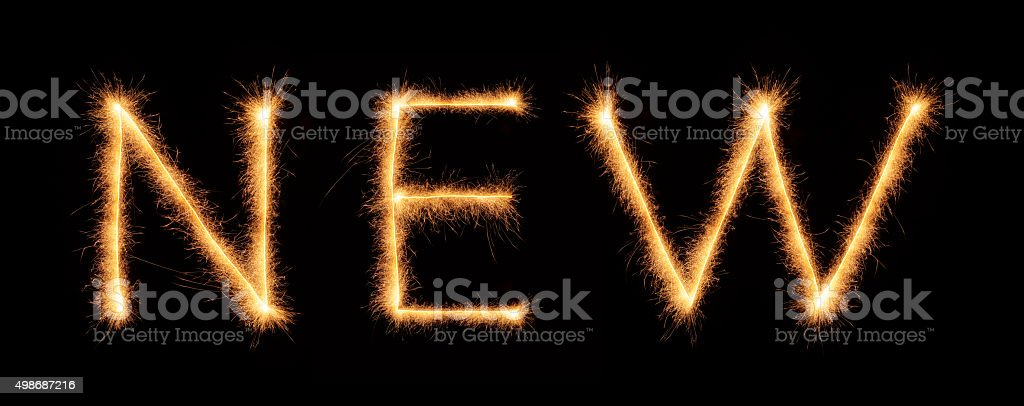'NEW' lettering drawn with bengali sparkles stock photo